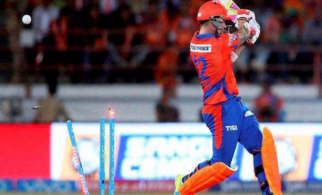 Brendon McCullum of Gujarat Lions gets clean bowled by Delhi Daredevils Zaheer Khan during...