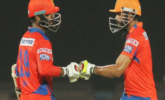 Dinesh Kartik of Gujrat Lions with a team mate during an IPL 2016 match against Delhi Daredevils...