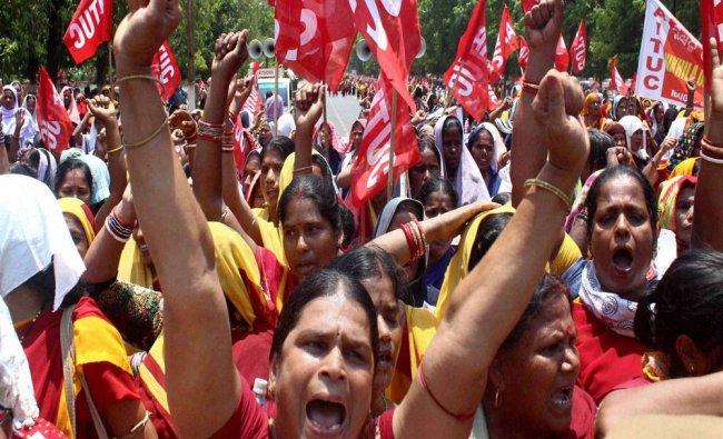 Anganwadi workers shouting slogans during a protest rally by members of Nikhila Odisha Anganwadi...