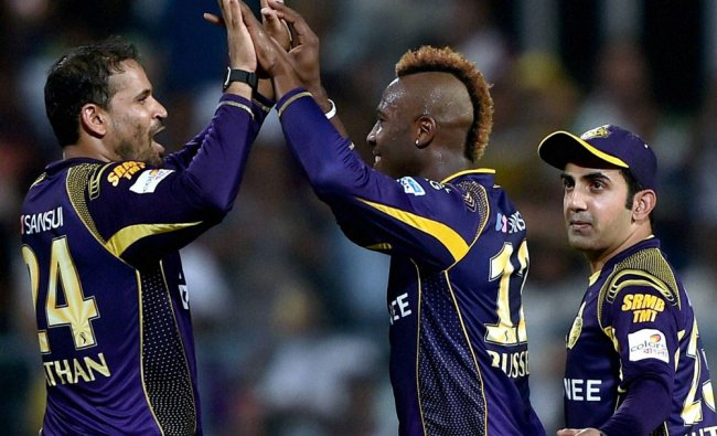 KKR bowler Andrew Russell jubilates with his teammate Yusuf Pathan,while captain Gautam Gambhir...