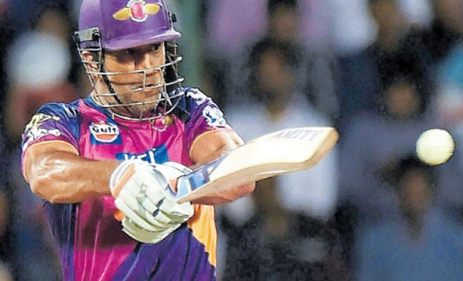 Rising Pune Supergiants player M S Dhoni plays a shot during an IPL T20 match against Delhi...
