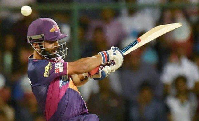 Rising Pune Supergiants player Ajinkya Rahane plays a shot during an IPL T20 match against Delhi...
