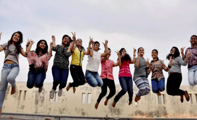Students celebrate their success after announcement of ICSE board results in Patna on Friday...