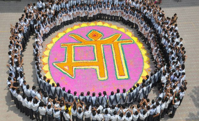 School children celebrate on the eve of Mother\'s Day in Moradabad...