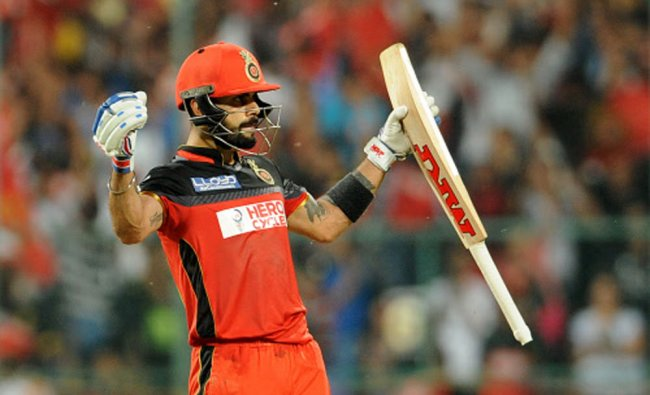 Royal Challengers Bangalore captain and batsman Virat Kohli celebrates hitting a century...