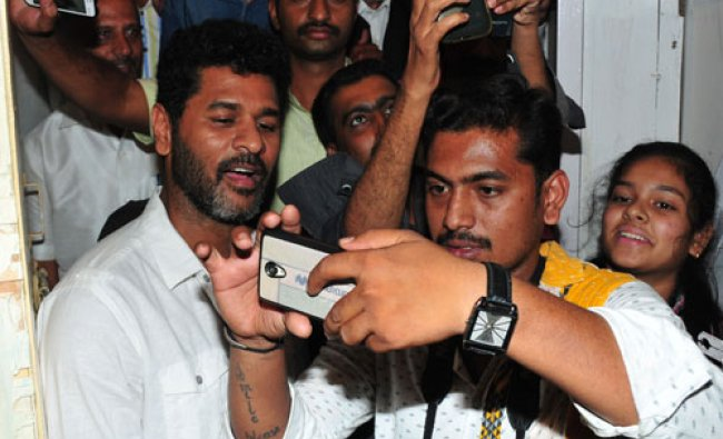 Film actor Prabhudeva pose for selfies with fans during valedictory ceremony of Basava Jayanthi...