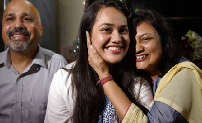 Tina Dabi who got the First rank in the Civil Services Exams 2015 with her parents...