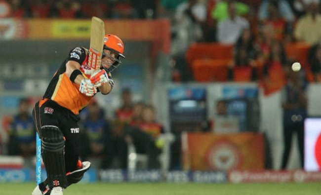Sunrisers Hyderabad captain David Warner plays a shot against Delhi Daredevils...