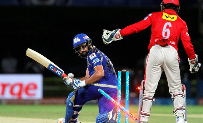 Mumbai Indians captain Rohit Sharma gets clean bowled during an IPL 2016 match ...