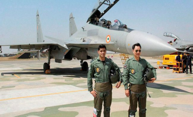 Minister of State for Home Kiren Rijiju with a fighter pilot after a sortie of about half...