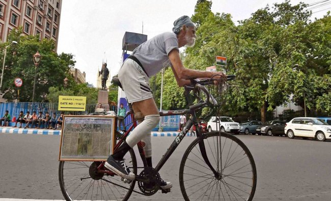 An elderly person cycling at the road in Kolkata on Wednesday...