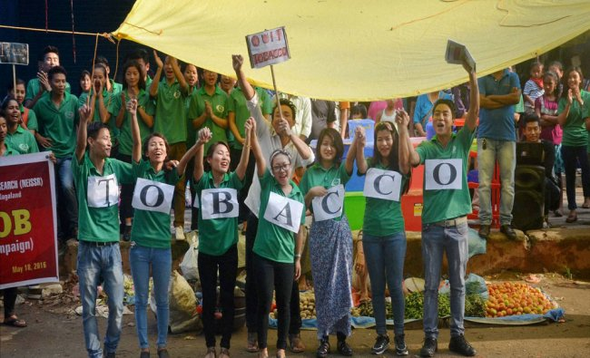 Students of North East Institute of Social Science and Research at a flash mob show against Tobacco