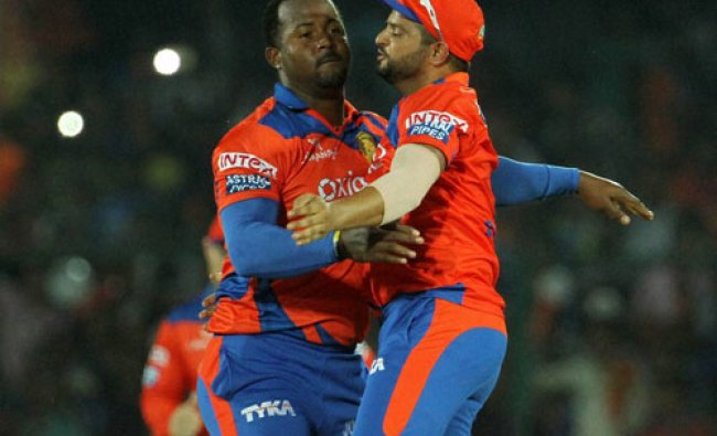 Gujarat Lions player Dwayne Smith and Gujarat Lions captain Suresh Raina celebrates the wicket...