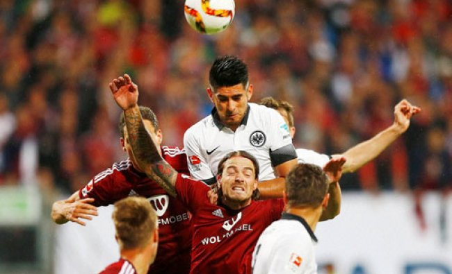 Nuremberg and Frankfurt players jump for the ball during a German first division Bundesliga soccer..
