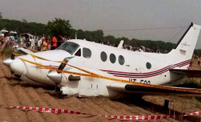 People watching the air ambulance which crash landed at Kair village in Najafgarh area...