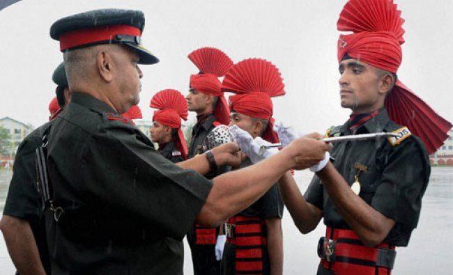 A senior Army Officer presents the Sher-e-Kashmir Sword of Honour to a new recruit...