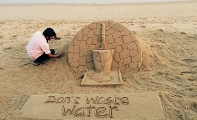 Renowned sand artist Sudarsan Pattnaik creates a sand art to aware people about water scarcity...
