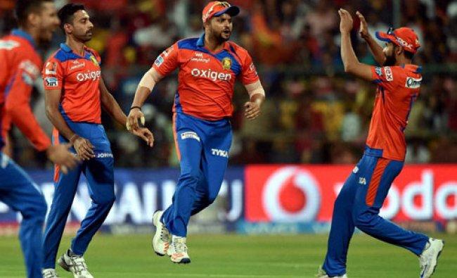 Gujarat Lions bowler Dhawal Kulkarni with Suresh Raina celebrates the wicket of K L Rahul...