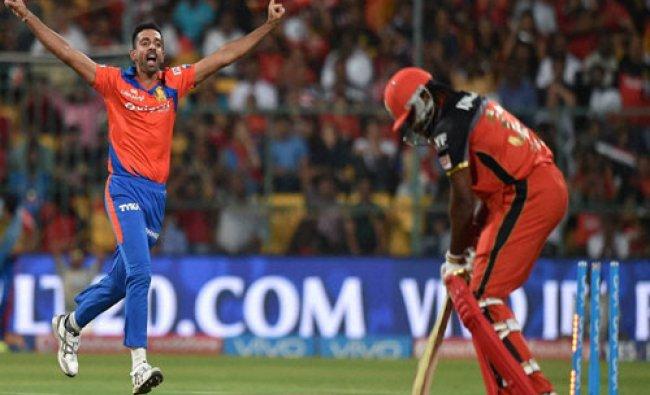 Gujarat Lions bowler Dhawal Kulkarni celebrates the wicket of Chris Gayle...
