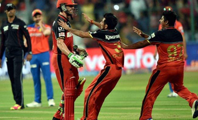 Royal Challengers Bangalore\'s AB De Villiers with team mates celebrate...