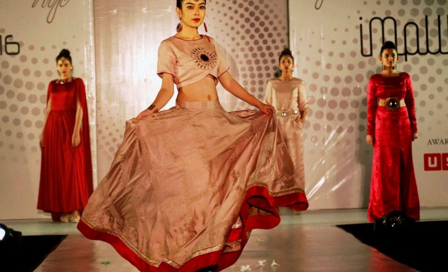 Models walk on a ramp during fashion show of students of National institute of fashion technology...