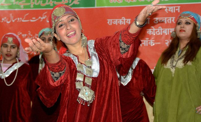 College girls dressed in traditional attire perform cultural show during anniversary of NDA govt...