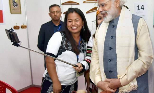 Girl takes selfie with Prime Minister Narendra Modi at exhibition on achievements of North East...