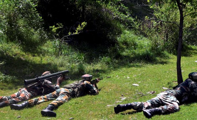 Army personnel take positions during an encounter with the militants at Naugam...