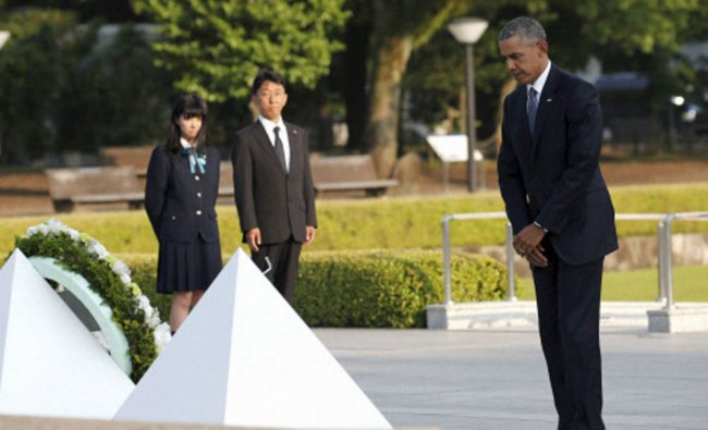 Obama stands after laying a wreath at the Hiroshima Peace Memorial Park in Hiroshima...