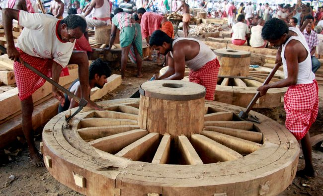 Carpenters completing the construction of the wheels for the forthcoming Lord Jagannath Yatra...