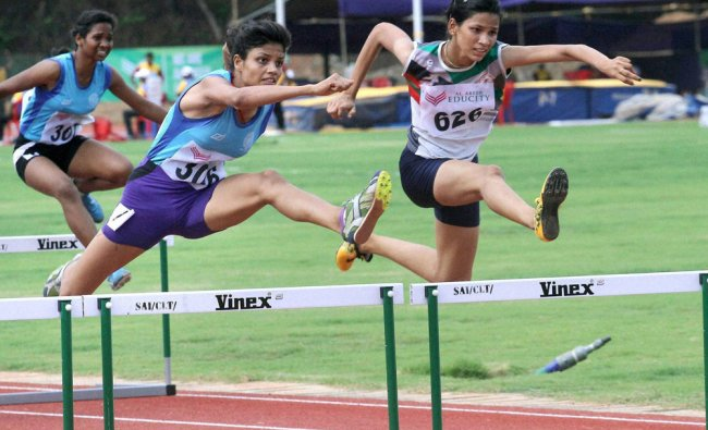 Y Jyothi (R) of Telangana competes to win gold in the 100m girls hurdles...