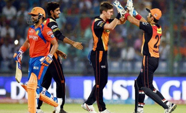 Sunrisers Hyderabad celebrate the dismissal of Gujarat Lions Captain Suresh Raina...