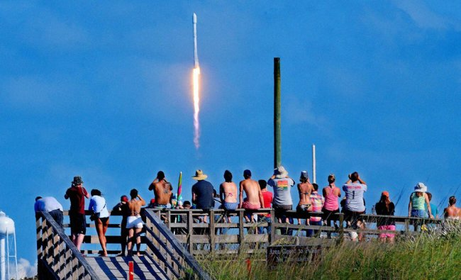 Crowds pack the Canaveral National Seashore Friday, to witness the liftoff of a SpaceX...
