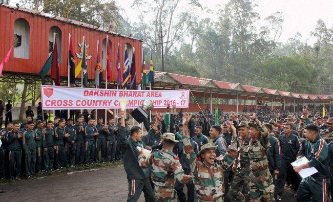 Madras Regimental jawans jubilate after winning the Dakshin Bharat Area Cross Country Championship..