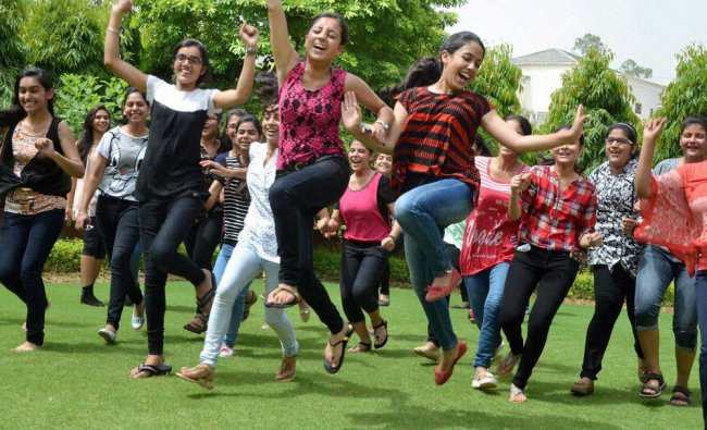 Students celebrate their success after CBSE announced its 10th class results...