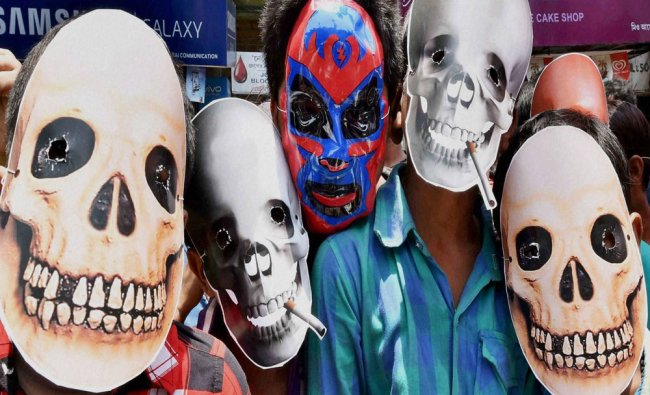 Children wear masks during an awareness campaign on \'World No Tobacco\' day in Kolkata...