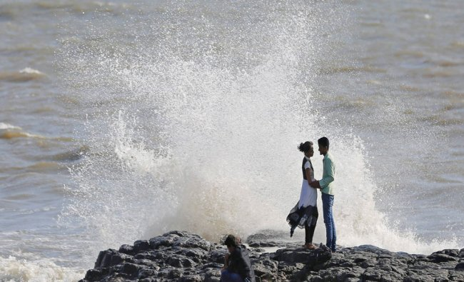 Couples embrace along the shores of the Arabian Sea in Mumbai, India ...