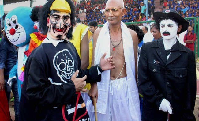 People dressed up as famous personalities taking part in the \'Carnival rally\' to mark World No...