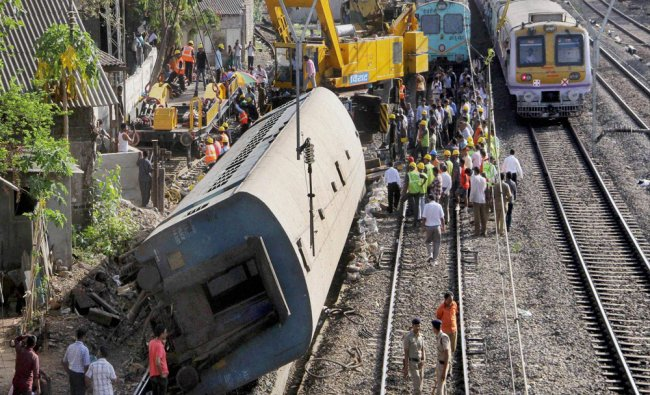 Restoration work in progress after an empty coach derailed off a slow track between Lower Parel...