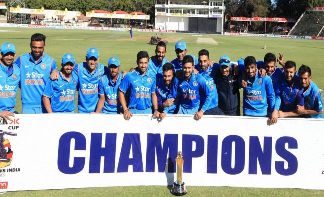 The Indian Cricket team poses for a photo with the trophy...