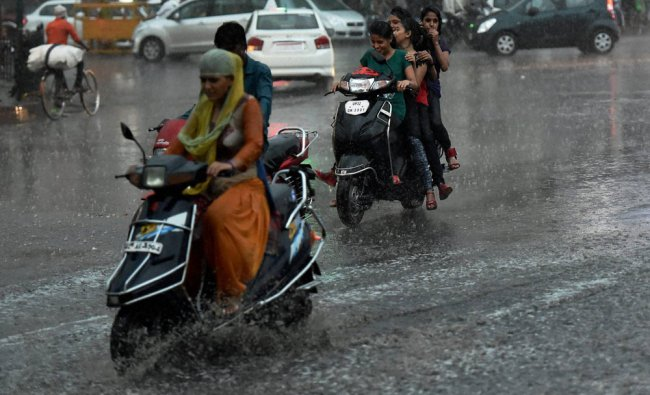 Lucknow: Girls ride scooter during...