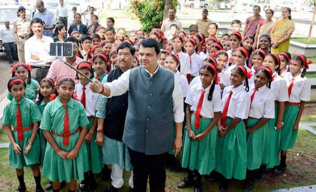Maharashtra Chief Minister Devendra Fadnavis take selfie with school children...