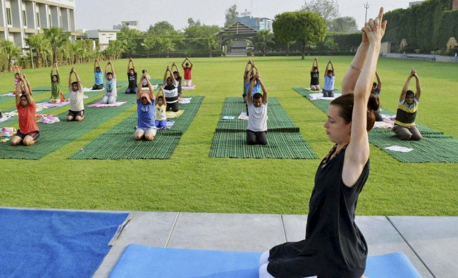 People practicing Yoga a day before World Yoga Day in Mathura...