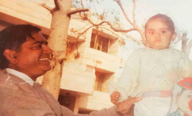 File Photo- Cricketer Virat Kohli with his father which he uploaded on his Twitter...