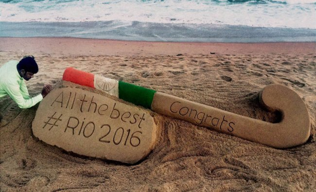 Renowned sand artist Sudarsan Pattnaik creates a sand sculpture to wish the Indian hockey team...