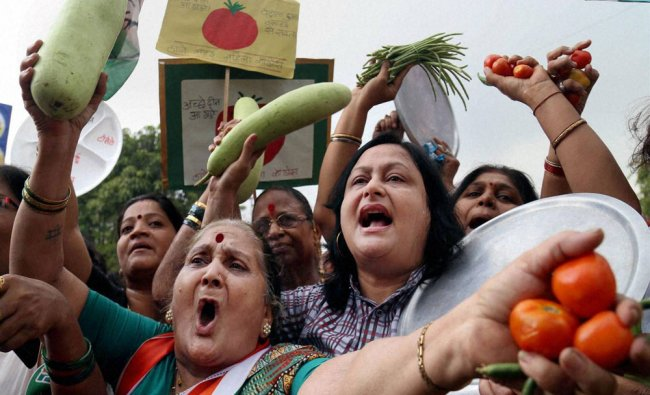 Mahila Congress members staging a protest against price rise in front of BJP Head office at Thane...