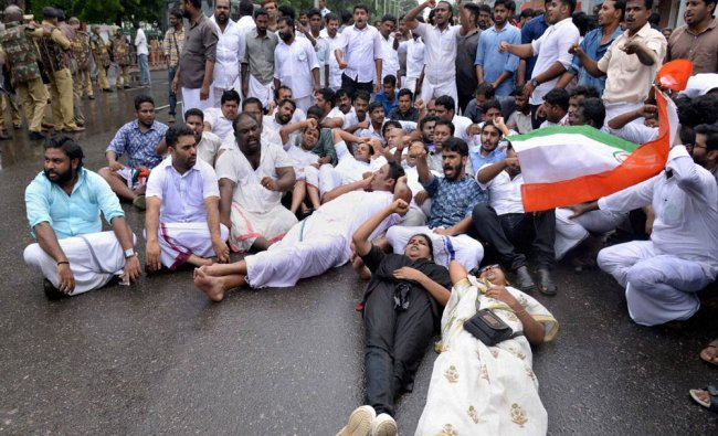 Youth Congress workers protesting over the arrest of two Dalit sisters at Thalassery in Kannur on..