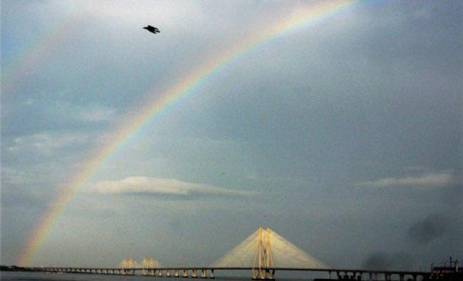 A rainbow appears in the sky over Rajiv Gandhi Bandra Worli Sea Link in Mumbai...