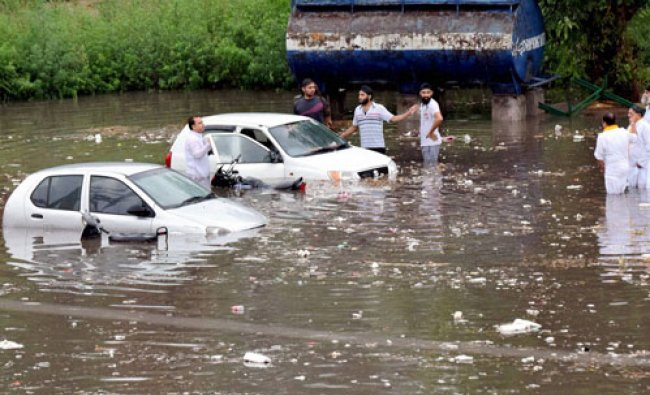 Vehicles submerge in water after heavy rainfall in Jammu...