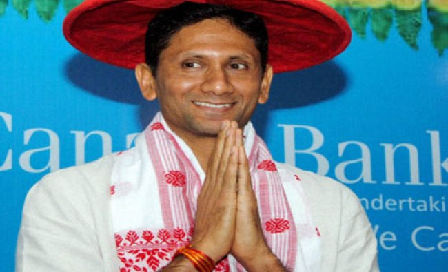 Former cricketer Venkatesh Prasad being feliciated with an Assamese traditional ...